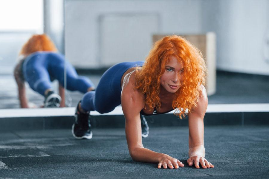 Sporty girl doing plank