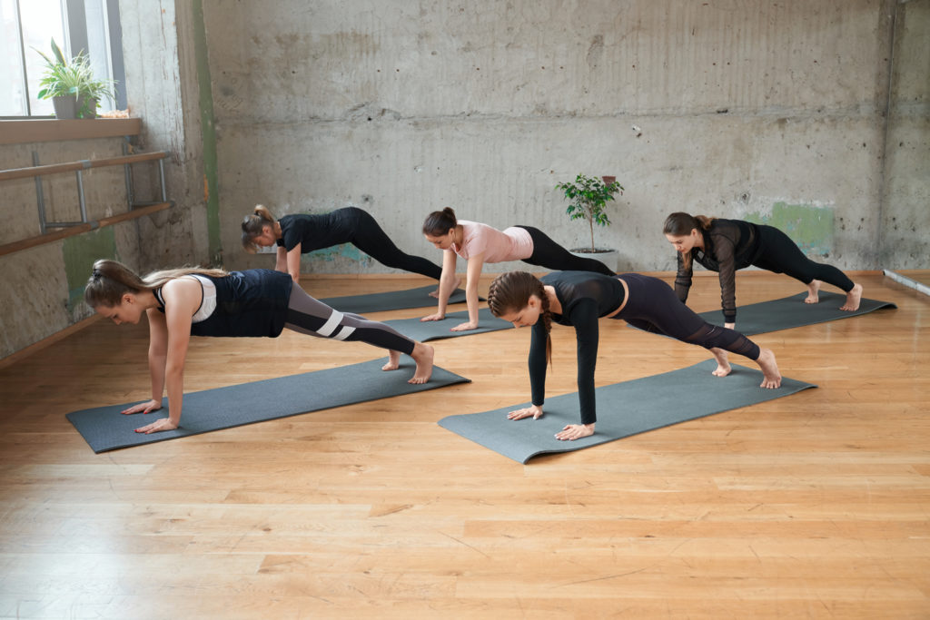 Group of women doing plank incorrectly