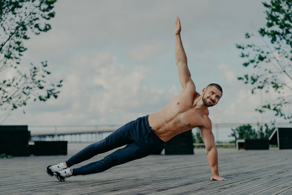 Man doing side plank for a strong core