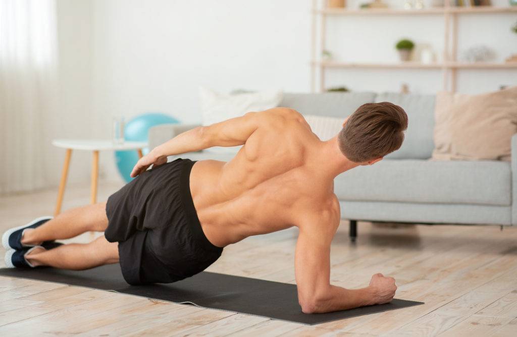 Man doing plank for a strong back