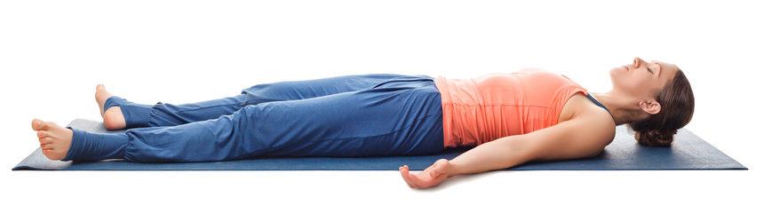 woman doing savasana or corpse pose