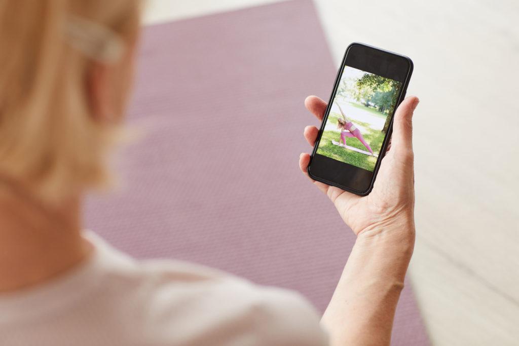 Woman watching yoga online
