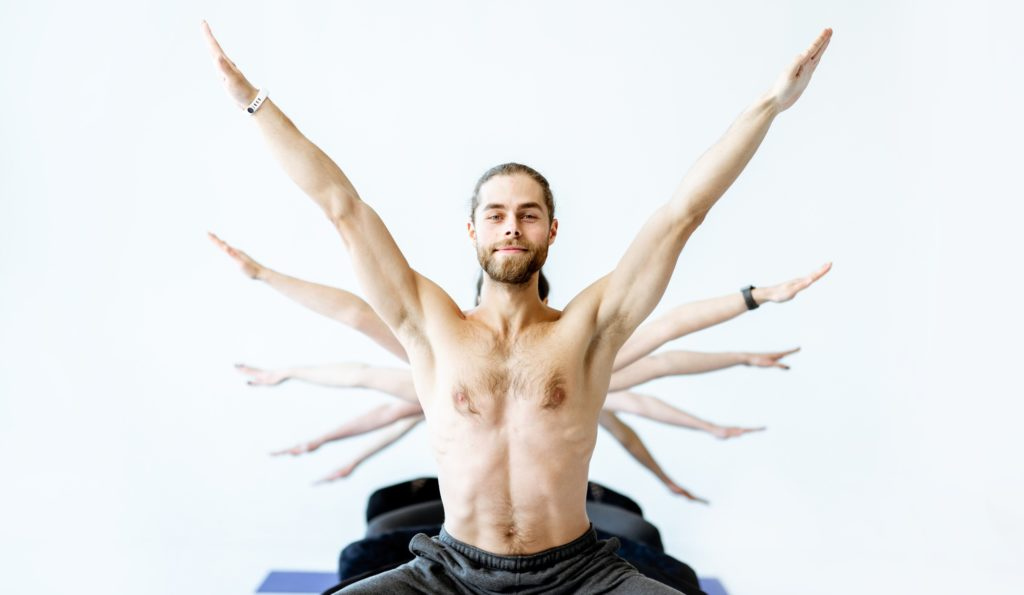 what-is-yoga-5-principles-man-in-yoga-pose-with-multiple-arms-on-the-background.jpg