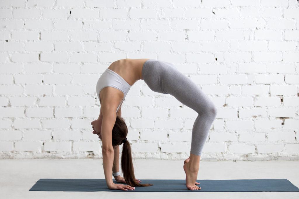 woman-practicing-yoga-doing-Setu-Bandha-Sarvangasana-Bridge-Pose-relieve-stress