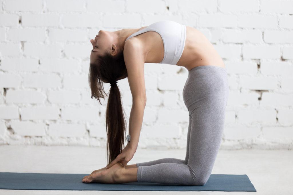 yoga-indoors-camel-pose-Ustrasana-relieve-stress