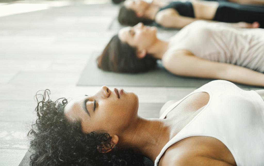 yogi-lying-in-savasana-corpse-pose-relaxation-relieve-stress