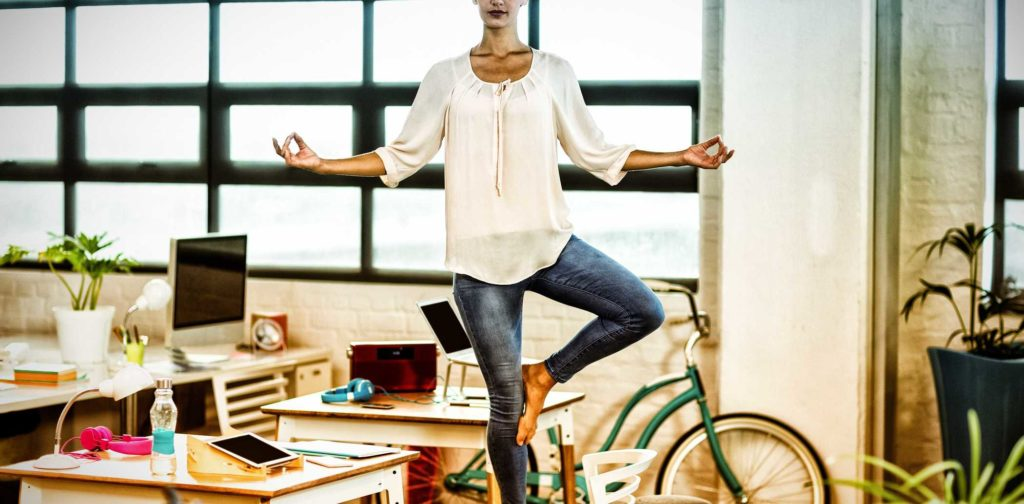 yoga-workplace-female-business-executive-performing-yoga-increase-focus-work-satisfaction-balance